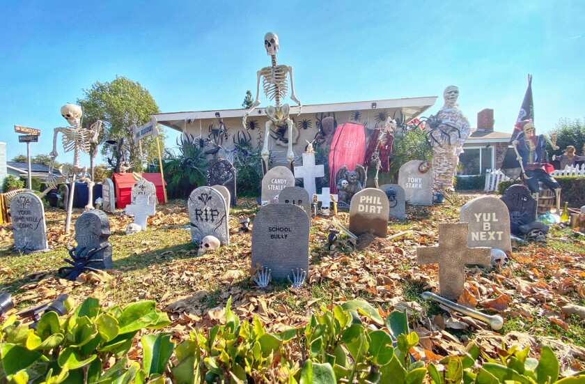 """The Inzunza family's Halloween """"cemetery,"""" filled with 37 tombstones, plus some skeletons and skulls."""