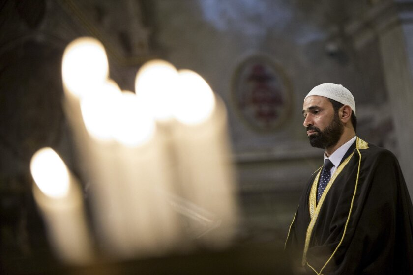 Imam Sami Salem delivers his speech during a Mass in Rome's Saint Mary in Trastevere church, Italy, Sunday, July 31, 2016. Imams and practicing Muslims attended Mass across Italy, from Palermo in the south to Milan in the north, in a sign of solidarity after the France church attack in which an eld