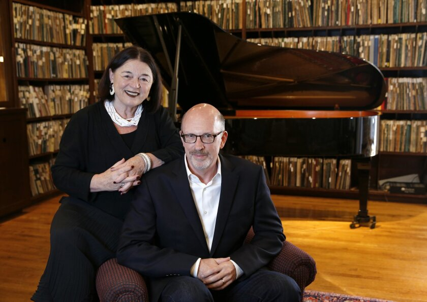 The La Jolla Athenaeum is celebrating 25th anniversary of its jazz concert series the first week of June. Erika Torri (left) ,the Athenaeum's Joan & Irwin Jacobs Executive Director and Athenaeum Jazz Program Coordinator Daniel Atkinson are seen in the room where the concerts are held. Photo by Nanc