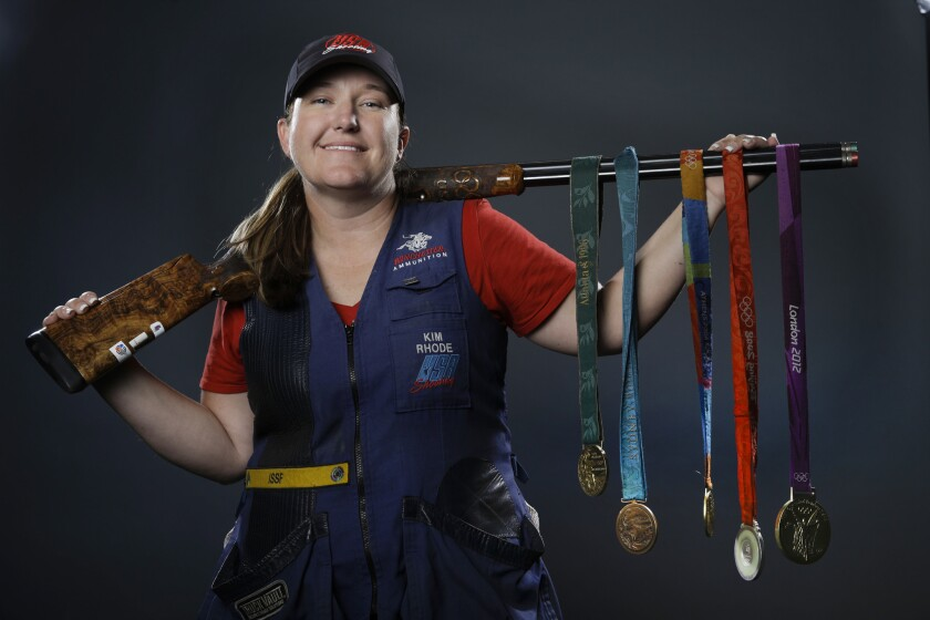 Double trap and skeet shooter Kim Rhode poses for photos with her Olympic medals at the 2016 Team USA media summit in Beverly Hills on March 8, 2016.