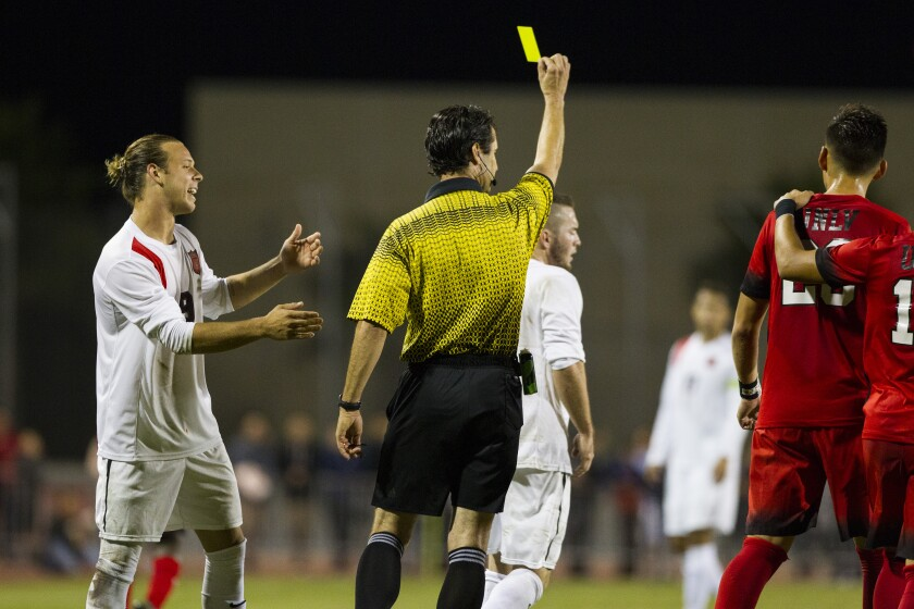 A yellow card is issued in this SDSU soccer game from 2016. Last year's game against USD had six yellow cards.