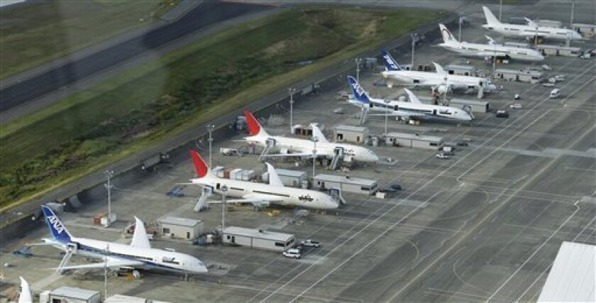 In this Sept. 8, 2010 photo, planes are shown parked at Boeing Co.'s airplane assembly facility in Everett, Wash., as seen from the air. Boeing Co. says it delivered 124 commercial airplanes during the third quarter, almost 10 percent more than last year. (AP Photo/Ted S. Warren)