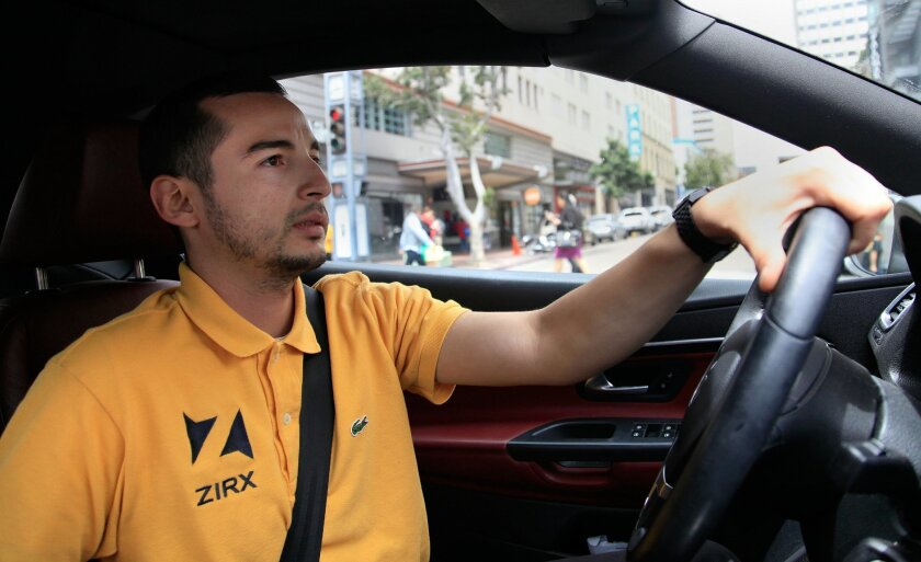 Valet at ZIRX Emmanuel Llamas, 25, takes a vehicle to a parking garage at an undisclosed location in Downtown. Started in Silicon Valley, ZIRX is an on-demand valet parking and car service now in San Diego.