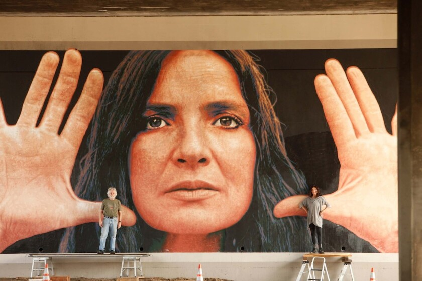 """Kent Twitchell is joined by the real woman named Lita in front of the restored (2012) """"Lita Albuquerque Monument."""""""