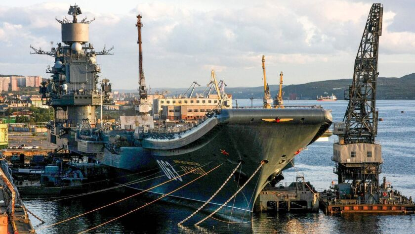 Russia's only aircraft carrier, the Admiral Kuznetsov, tied up in port in Murmansk in 2009. One person was missing and four others injured Oct. 30, 2018, after a giant floating dock holding the Kuznetsov sank at a shipyard near Murmansk.