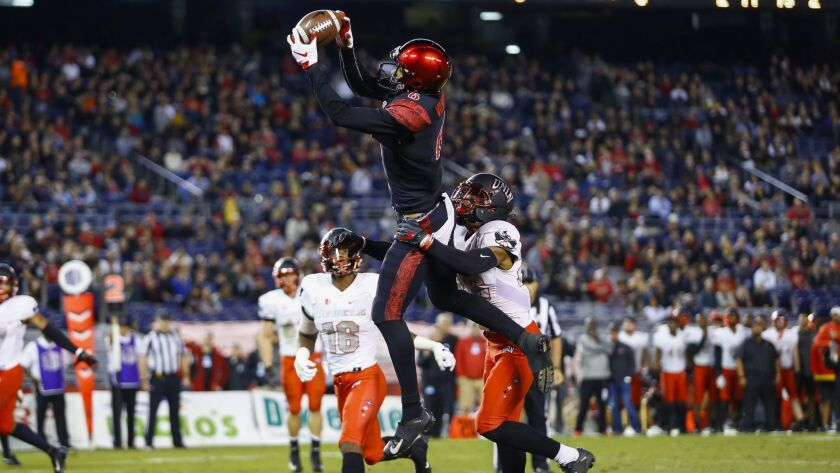 San Diego State wide receiver Tim Wilson Jr. hauls in a touchdown pass from Christian Chapman in the second quarter against UNLV. Wilson also had a touchdown catch in the third quarter from quarterback Ryan Agnew.