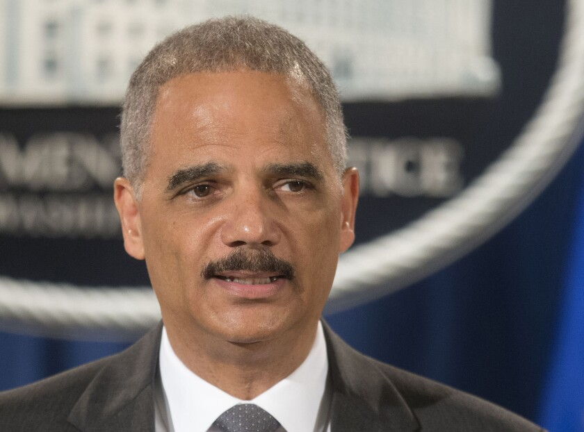 """""""I am deeply concerned that the deployment of military equipment and vehicles sends a conflicting message,"""" Atty. Gen. Eric Holder said of the situation in Ferguson, Mo."""