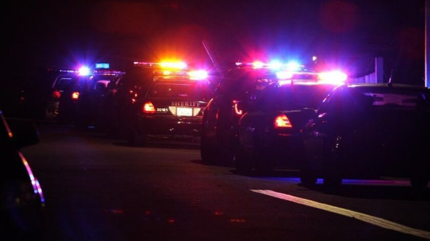 A row of police cars pulled over