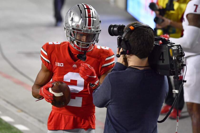 Ohio State's Chris Olave, a former star at Mission Hills High, smiles for the camera.