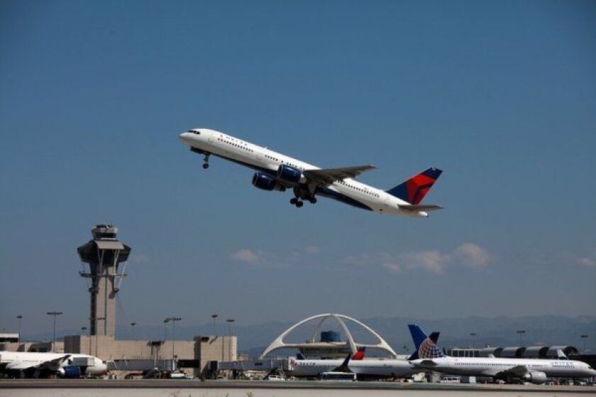 A jet takes off from Los Angeles International Airport. A new law signed Sunday by Gov. Jerry Brown gives statewide authority to officers of the Los Angeles Airport Police Department, which employs about 1,100 sworn and civilian personnel.