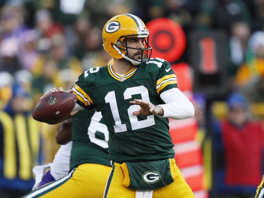 "Green Bay Packers' quarterback Aaron Rodgers throws during an NFL football game against the Minnesota Vikings this month. The Packers meet the Detroit Lions in ""Sunday Night Football"" on Jan. 1."