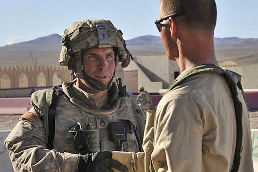 """Army Staff Sgt. Robert Bales, left, in 2011. His lawyer says Bales suffered traumatic incidents during his four deployments in Iraq and Afghanistan. One in particular """"deeply affected him; it profoundly affected him."""""""