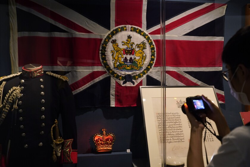 """The standard and uniform of the former British Governors of Hong Kong, are displayed at the exhibition """"The Hong Kong Story"""" in the Hong Kong Museum of History, Friday, Oct. 16, 2020. The exhibition """"The Hong Kong Story"""" will be temporarily closed from 19 Oct 2020 for an extensive revamp. (AP Photo/Kin Cheung)"""