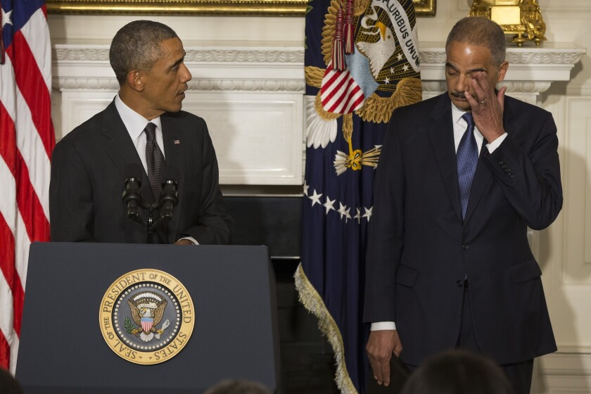 President Obama, with Atty. Gen. Eric H. Holder Jr., praises the tenure of the Justice Department chief at the White House on Thursday.