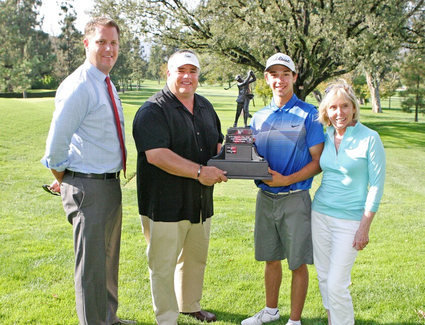 Co-chairs Kris Hons and Rick Dinger, winner Vinny De Pinto, and Dotty Sharkey, president of Glendale Parks and Open Space Foundation, with the Glendale City Championship trophy at Oakmont Country Club in Glendale on Monday, July 28, 2014.