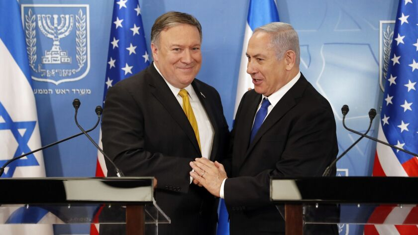 U.S. Secretary of State Mike Pompeo. left. is greeted by Israeli Prime Minister Benjamin Netanyahu a