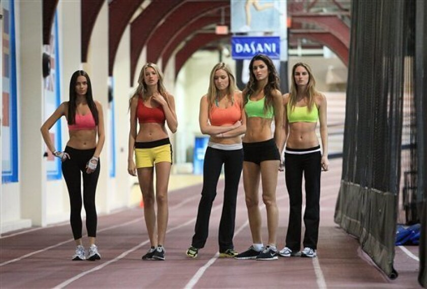 This photo taken Nov. 11, 2009 shows Alicia Hall from Las Vegas, NV, far left, Kylie Bisutti from Simi Valley, Calif, second from left, Jamie Lee Darley from Carmel, Calif, center, Tika Ivezaj from Detroit, Mich, second from right, and Allison Turner from Cape Girardeau, Mo, far right, the five r