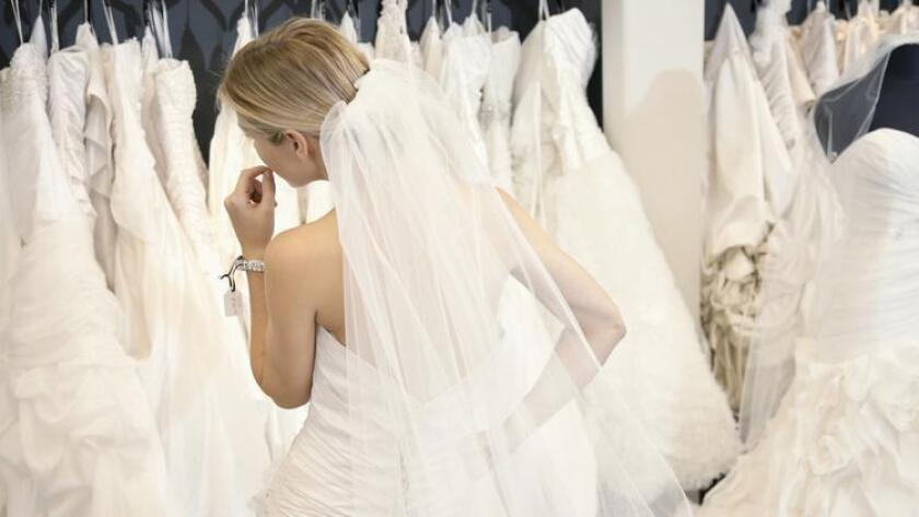 Wedding dress shopping doesn't have to add drama to your life. (/ Shutterstock.com)