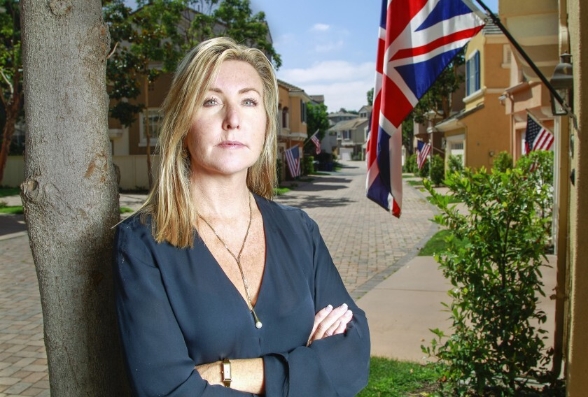 Shannon Glover stands near the British flag her Carmel Valley HOA has ordered her to remove.
