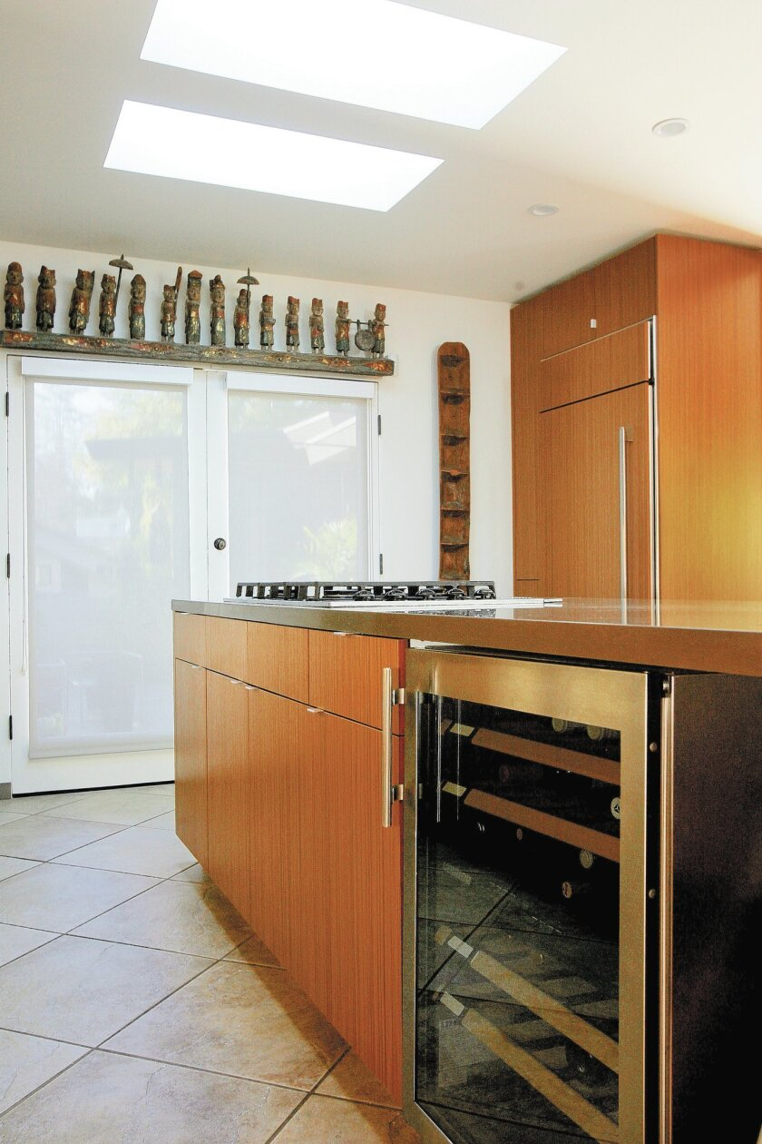 Teak cabinets and Chroma quartz countertops are featured in Krasne's kitchen.