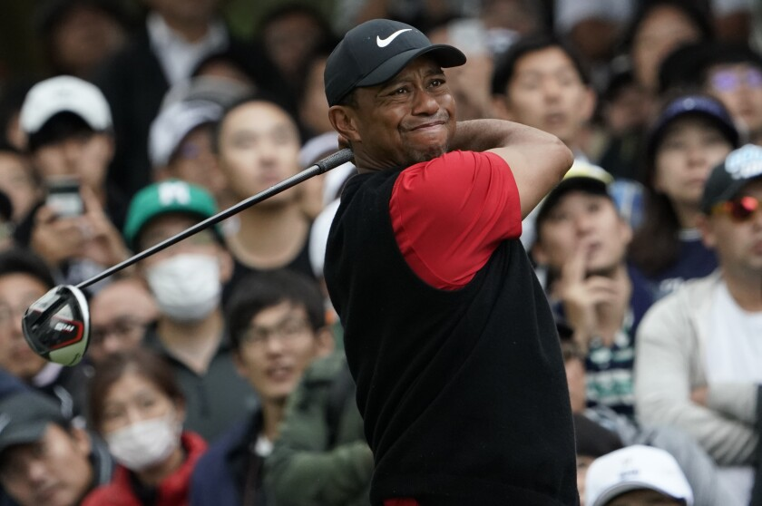 Tiger Woods watches his tee shot at the sixth hole during the final round of the Zozo Championship at the Accordia Golf Narashino Country Club on Oct. 27, 2019.