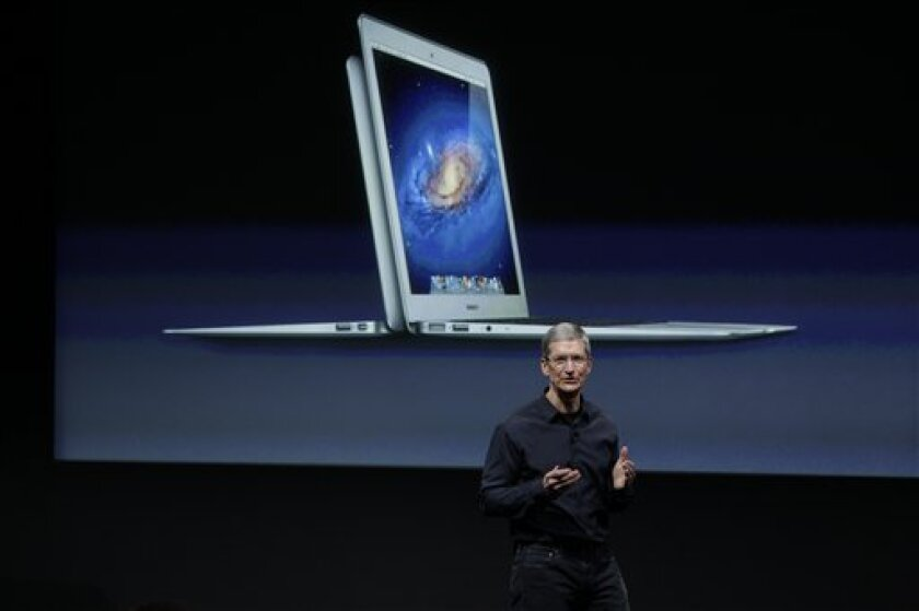 Apple CEO Tim Cook gestures during the announcement at Apple headquarters in Cupertino, Calif., Tuesday, Oct. 4, 2011. (AP Photo/Paul Sakuma)
