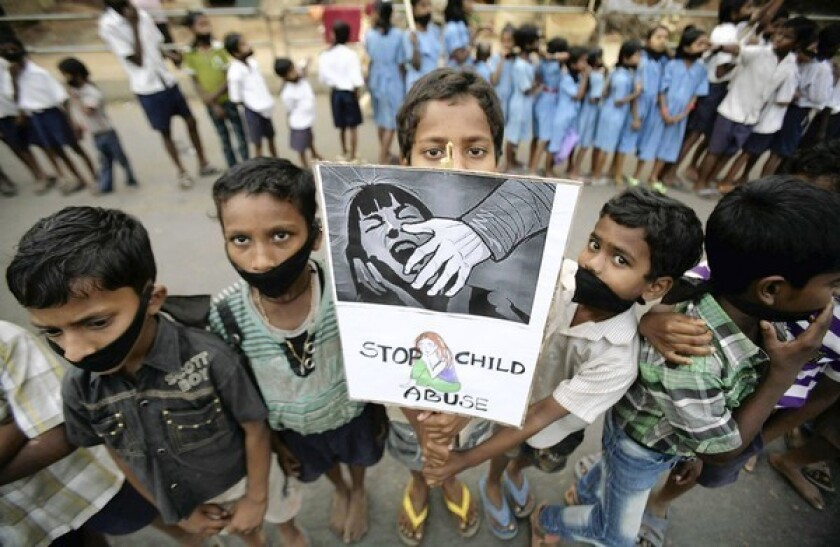 Indian children participate Saturday in Bhubaneswar, India, in a protest against child abuse and rising crimes against women. India has seen outrage and widespread protests against rape and attacks on women.