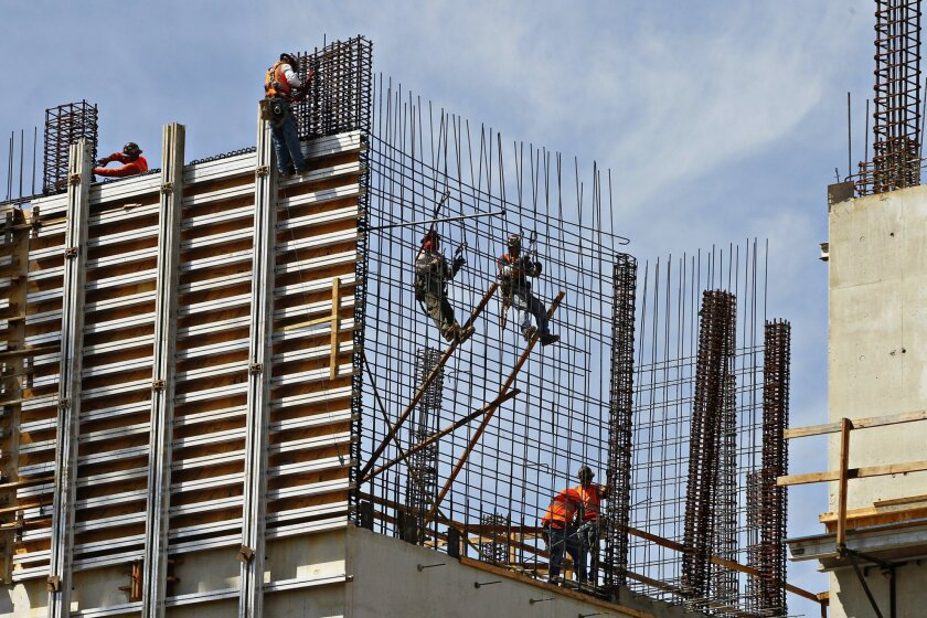 Construction crews build the new Health Sciences Biomedical Research Facility/ Leichtag Hall II on Wednesday in at UCSD in San Diego, California.