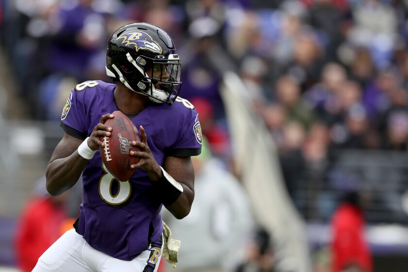 Ravens quarterback Lamar Jackson looks to pass during a game against the Texans on Nov. 17 at M&T Bank Stadium.