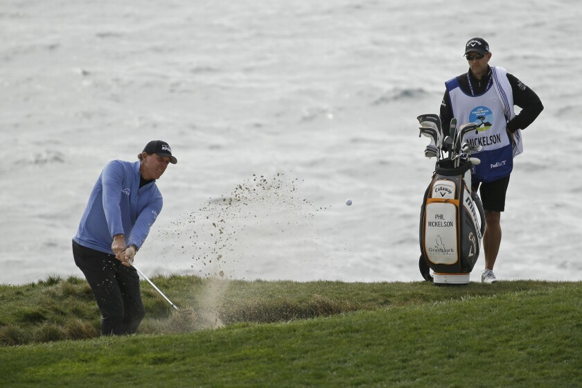Phil Mickelson hits out of a bunker on No. 7 at Pebble Beach Golf Links during the third round Feb. 8, 2020.