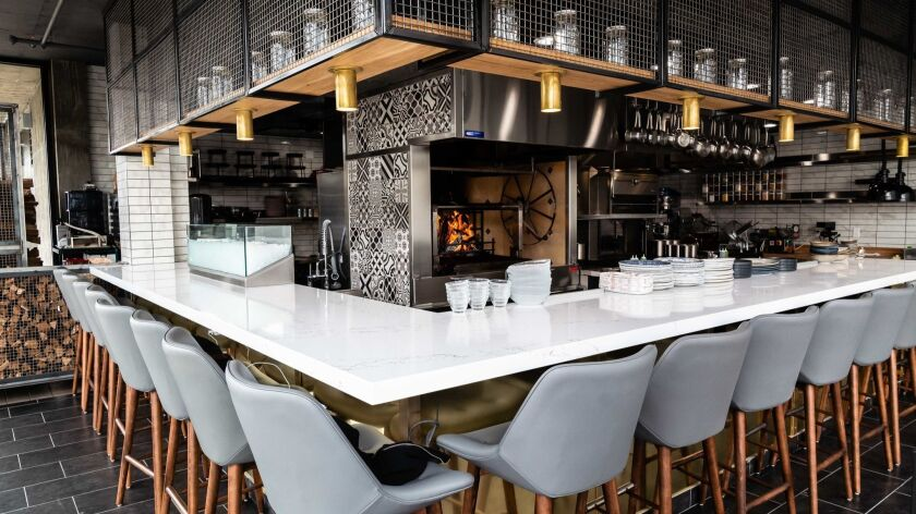 Fort Oak's 14-seat counter surrounds the Mission Hills restaurant's 7,000-pound custom wood grill.