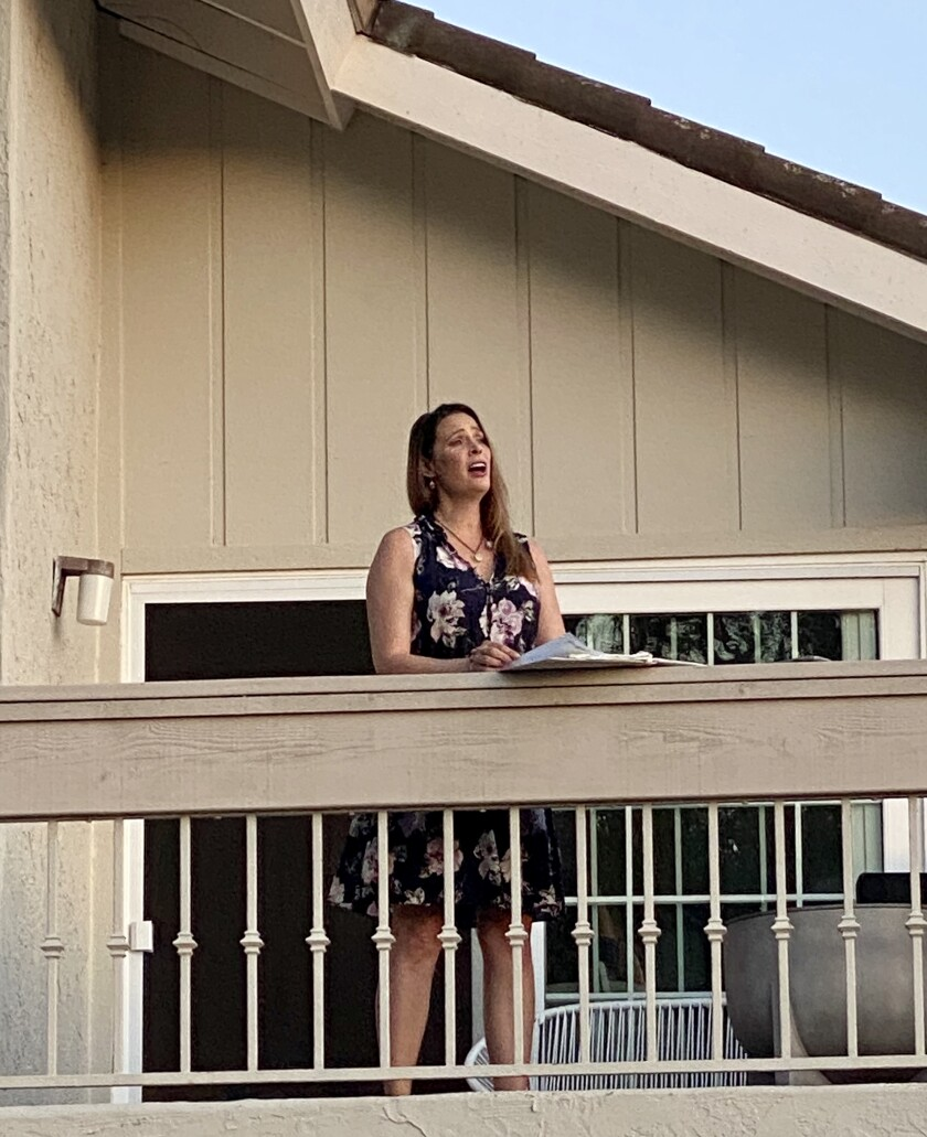 Professional opera singer Alina Mullen performs for her neighbors from her balcony in La Jolla on May 8.