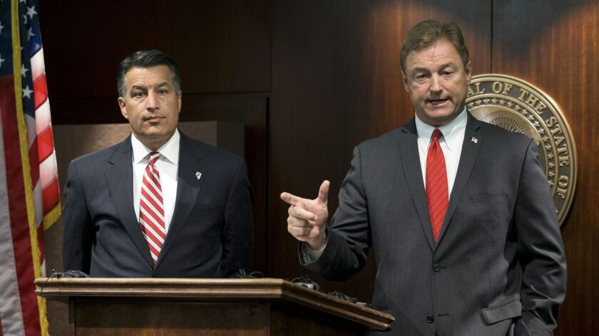Nevada Gov. Brian Sandoval, left, and Sen. Dean Heller during a press conference where the senator a