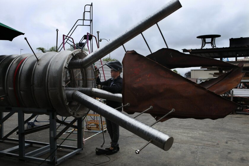 Chula Vista artist Michael Leaf makes some finishing touches to the sculpture he created that memorializes the South Bay Power Plant. The three-piece monument is set to be installed Friday.