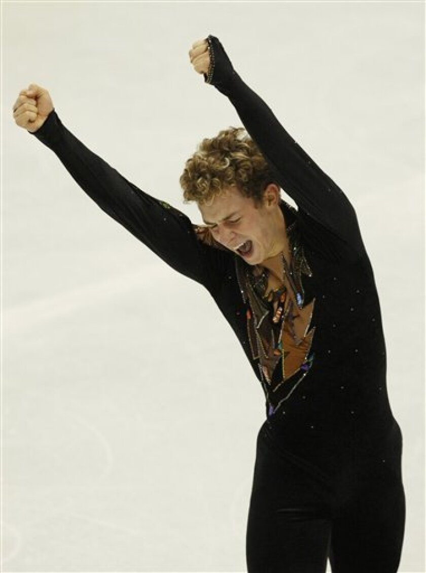Adam Rippon of the U.S. reacts after men's free event at the ISU Four Continents Figure Skating Championships in Jeonju, South Korea, Saturday, Jan. 30, 2010. Rippon won the men's singles title. (AP Photo/Ahn Young-joon)