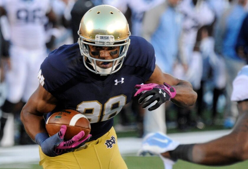 FILE - In this Oct. 11, 2014, file photo, Notre Dame wide receiver Corey Robinson makes a catch during an NCAA college football game against North Carolina in South Bend, Ind. Robinson is not worried that being the first Notre Dame football player elected to be the student body president will be a