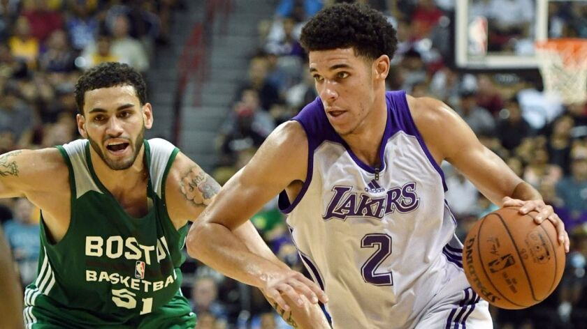 """The Lakers' Lonzo Ball, shown driving the ball against the Celtics' Abdel Nader during a summer league game, """"can be one of the best rookies in the league,"""" according to Jason Kidd."""