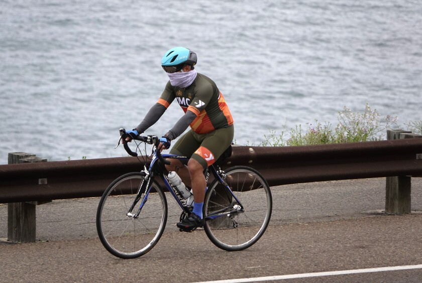 A cyclist rides along Coast Highway in Encinitas in early April.