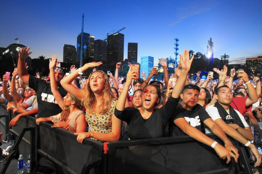 The crowd enjoys a performance at the Made in America festival Aug. 30 at Grand Park in downtown L.A. Mayor Eric Garcetti said the event provided a benefit to the city that exceeded any unreimbursed expenses.