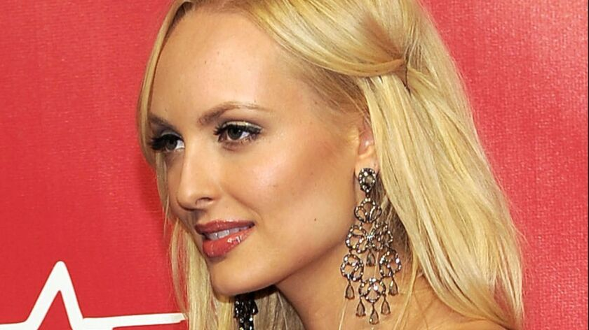 FILE - In this Feb. 10, 2012, file photo, Playboy bunny Shera Bechard arrives at the MusiCares Perso