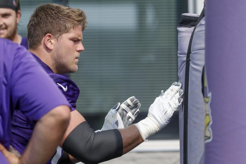 Minnesota Vikings tackle Brian O'Neill works a drill during NFL football training camp Friday, July 30, 2021, in Eagan, Minn. (AP Photo/Bruce Kluckhohn)