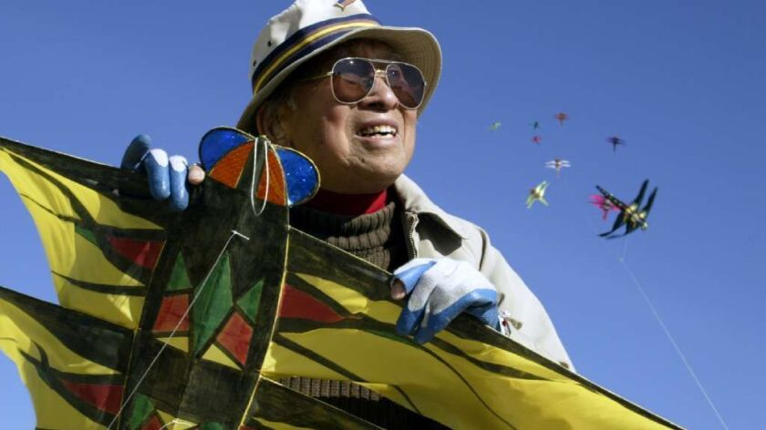 Tyrus Wong, a pioneering Chinese American artist, is seen here at the beach in Santa Monica in 2004 with some of the kites he designed and built.
