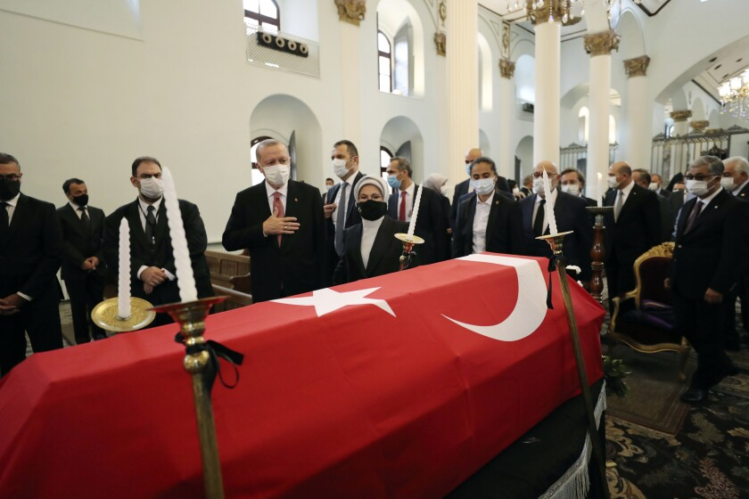 Turkey's President Recep Tayyip Erdogan, fourth left, and his wife Emine Erdogan attend a funeral ceremony for Markar Esayan, a Turkish lawmaker from Erdogan's ruling Justice and Development Party, who died of cancer at 51, at the Armenian Patriarchate Church, in Istanbul, Thursday, Oct. 22, 2020.(Turkish Presidency via AP, Pool)