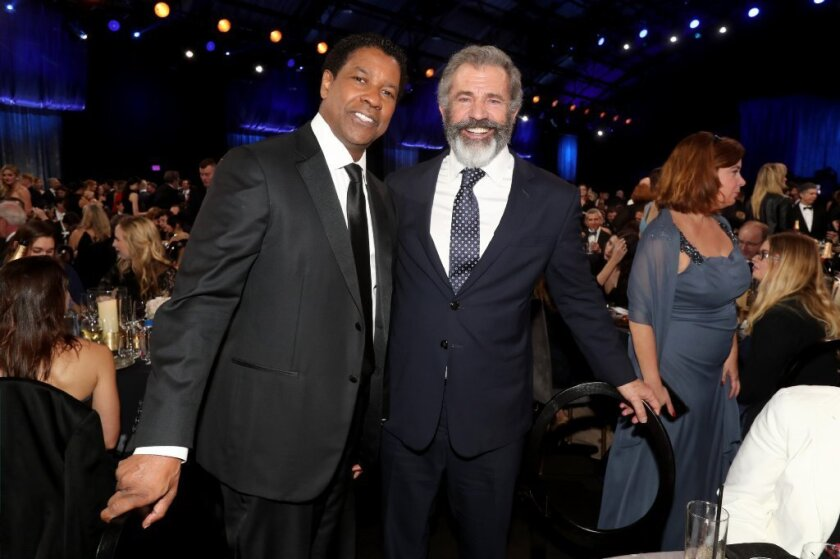 Denzel Washington, left, and Mel Gibson at the Critics Choice Awards.