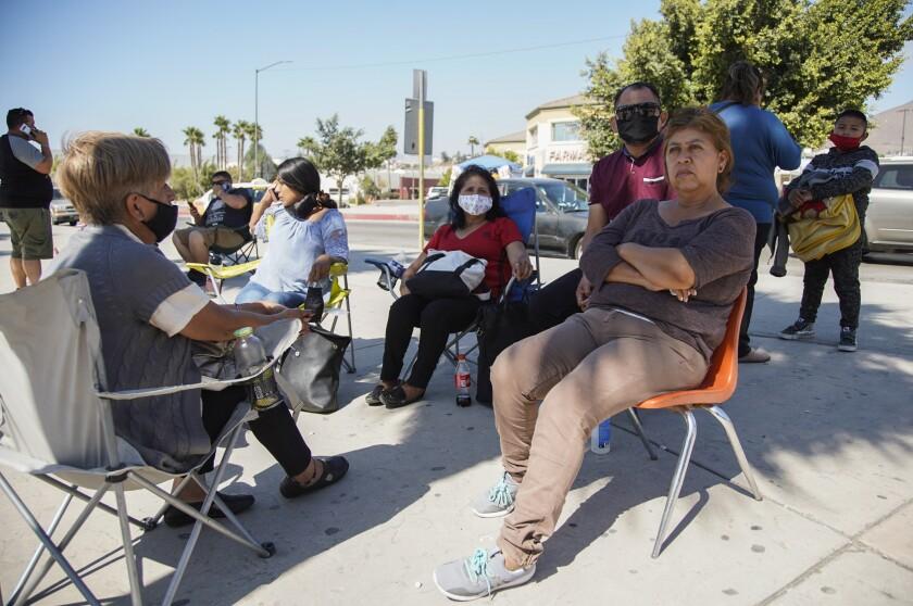 A family waits outside Tijuana hospital