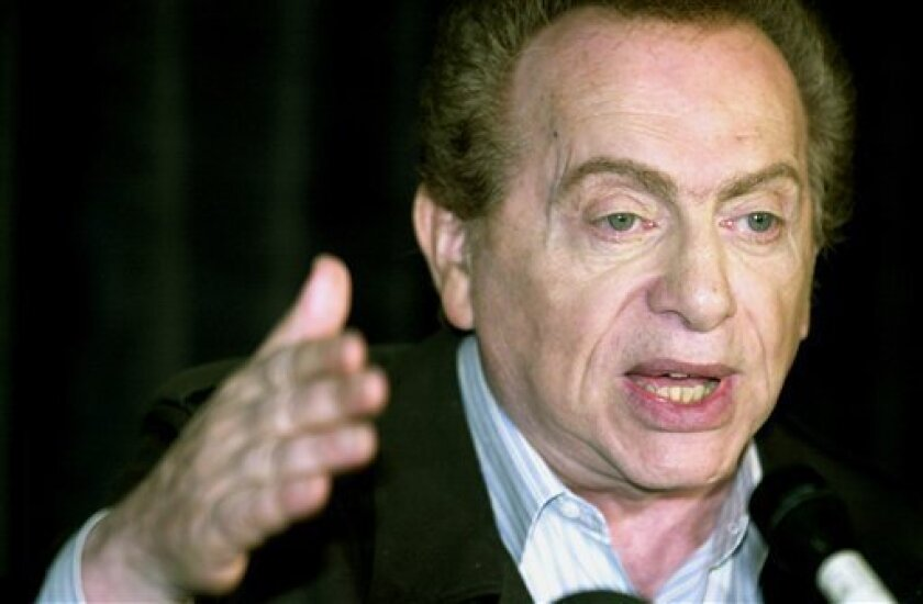 FILE- In this Aug 28, 2002, comic Jackie Mason addresses the media at a comedy club in Chicago. On Friday, March 30, 2012, New York City Police Commissioner Raymond Kelly said that the NYPD is investigating allegations that the comic roughed up a female companion. Kelly said the alleged altercation