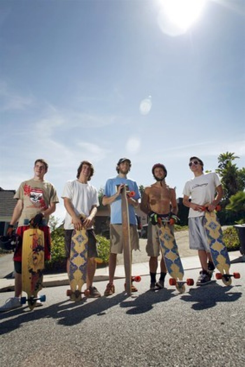 Longboarders are shown at the popular Franklin Street hill in Santa Monica. From left, Kevin Reimer, 19, of Vancouver, Canada; James Kelly, 18, of Petaluma, Calif.; Adam Stokowski, 23, of Springfield, Va.; Adam Colton, 25, of Santa Monica; and Louis Pilloni, 22, of Thousand Oaks.
