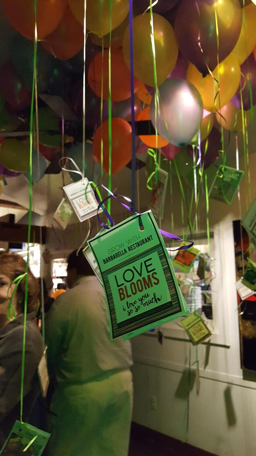 To promote Beltaire's new charity, I Love You So So Much, tags attached to seed packets hang from balloons.