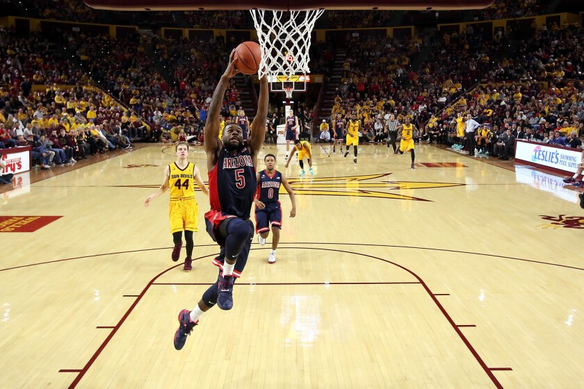 Arizona guard Kadeem Allen dunks during the second half of a game against Arizona State.