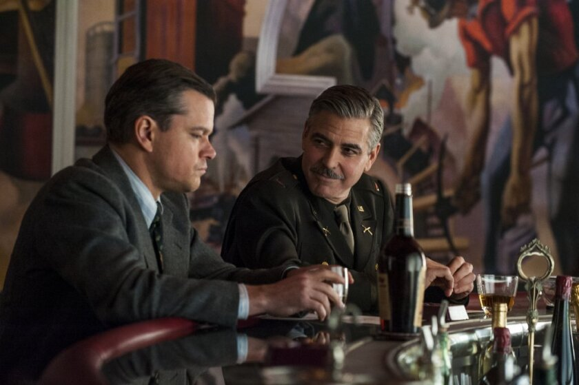 "Matt Damon, left, and George Clooney in ""The Monuments Men."""